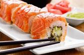 Philadelphia roll sushi on a white plate — Stock Photo