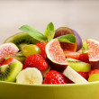 Healthy fruit mix salad on the kitchen table — Stock Photo