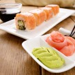 Philadelphia roll sushi on a white plate with soy sauce wasabi a — Stock Photo
