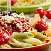 Pasta penne with bolognese sauce — Stock Photo