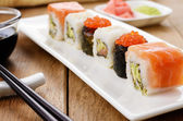 Mixed sushi on a white plate — Stock Photo