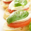 Caprese sandwiches with mozzarella - Stock Photo