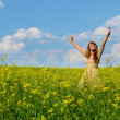 Young woman at canola field — Stock Photo #27475737