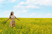 Young woman at canola field — Stock Photo