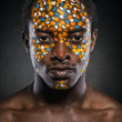 Stock Photo: Beauty portrait of handsome ethnic africmale with creative make-up