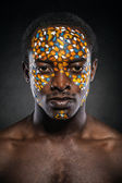 Beauty portrait of handsome ethnic african male with creative make-up — Stock Photo