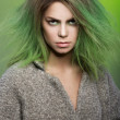 Blonde beautiful girl with green coloured hairstyle — Stock Photo