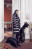 Fashion model posing in a fur coat — Stock Photo