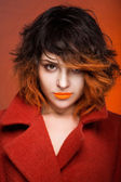 Brunette beautiful girl with orange coloured hairstyle and lips — Stock Photo