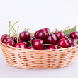 Cherries in wicker basket — Stock Photo