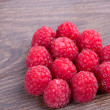 Raspberries on a wooden table — Stock Photo