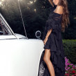 Beautiful sexy girl beside an expensive white car — Foto Stock