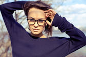 Beautiful stylish fashion model girl wearing glasses — Stock Photo