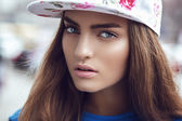 Beautiful girl in a cap — Stock Photo