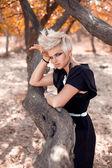 Woman near trees — Foto Stock