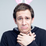 Man wearing bunny ears — Stock Photo