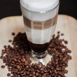 Latte and coffee beans  — Photo