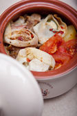 Appetizer in a ceramic pot — Stock Photo