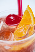 Cocktail with orange and cherry — Stock Photo