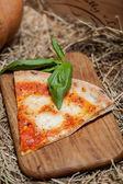 Pizza with tomato sauce — Stock Photo