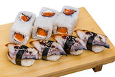 Sushi roll set and eel sashimi — Stock Photo