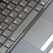 Netbook keyboard and mouse — Stock Photo