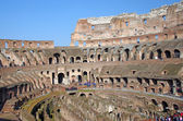 Tourists inside Colosseum — Stock Photo
