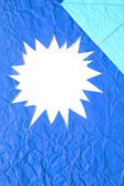 Star blank crumpled paper in blue — Stock Photo