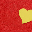 Heart icon on crumpled paper background — Stock Photo