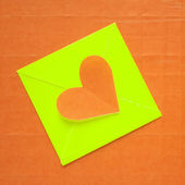 Heart envelope paper on orange background — Stock Photo