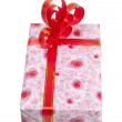 Single red gift box with silver ribbon on white background. — Stock Photo