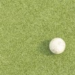 Stock Photo: White Golf ball on green grass left side background