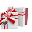 Single red gift box with silver ribbon on white background.  — Foto de Stock