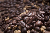 Coffee cup and beans on a white background. — Stock Photo