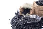 Black beans in bag — ストック写真