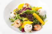 Squid salad with prawns and mango — Stock Photo