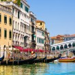 Venice Grand canal with gondolas and Rialto Bridge, Italy — Stockfoto #22460293