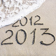 Happy New Year 2013 replace 2012 concept on the sea beach — Stock Photo