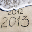 Happy New Year 2013 replace 2012 concept on the sea beach — Stock Photo #22460583
