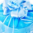 Stock Photo: Festive packed blue nacreous present with big bow isolated on wh