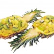 Vitamin healthy fruit mix in pineapple bowl — Stock Photo