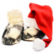 Red santa hat and warm woolen boots - christmas or new year's c — Stock Photo