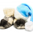 Blue santa hat and warm woolen  boots - christmas or new year's  — Stock Photo