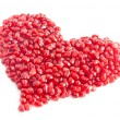 Ripe pomegranate seeds in form of heart isolated on white backgr — Stock Photo #22461203