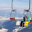 Snowboarders couple on ski lift — Stock Photo #22461461