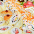 Appetizing tasty Japan rolls and sushi assortment - Stock Photo