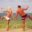 Man and woman go to diving on summer beach - positive concept — Stock Photo