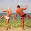 Man and woman go to diving on summer beach - positive concept — Stock Photo #22462173