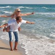 Loving couple walking on the sea beach at summer — Stock Photo
