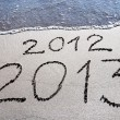 New Year 2013 replace 2012 concept on sebeach — Stock Photo #22462321